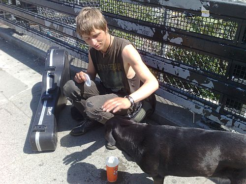 1 Blond Musician on Commercial Dr petting dog