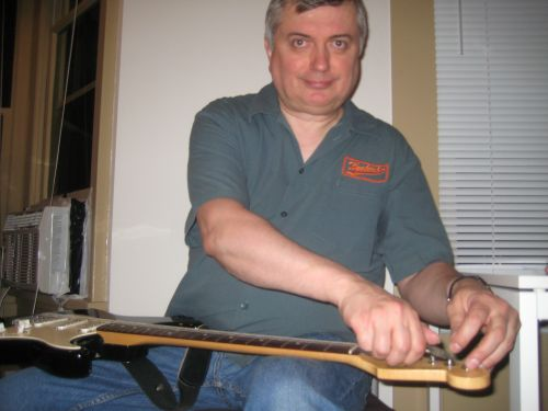 Al Restringing a guitar 1 500