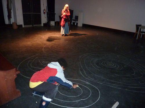 Savanah Walling watching young artist create