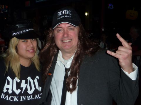 11 April Smith with Al Tkatch dressed up as Angus Young