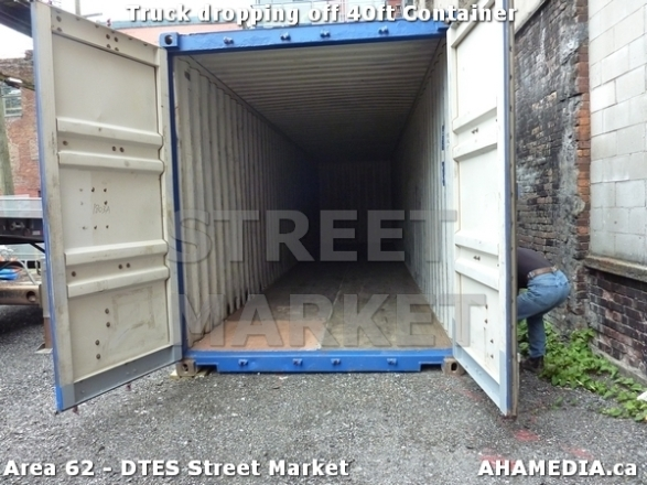23 AHA MEDIA sees Truck drop off 40ft Storage Container for DTES