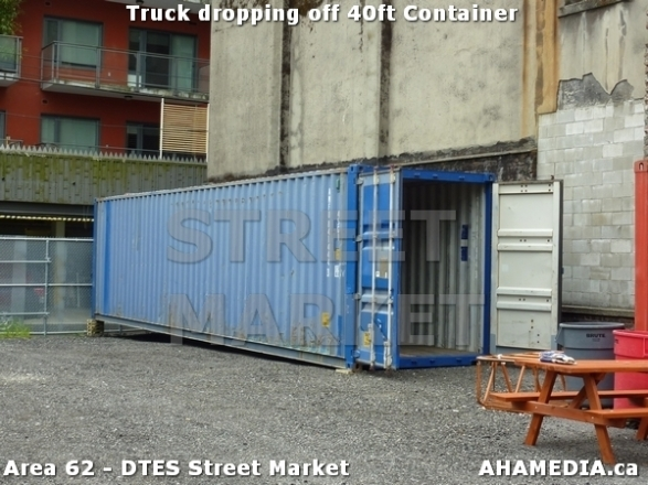 29 AHA MEDIA sees Truck drop off 40ft Storage Container for DTES