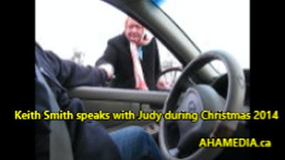 1 Keith Smith speaks with Judy during Christmas 2014