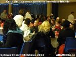 49 Keith Smith serves dinner to homeless friends at Uptown Church Christmas 2014