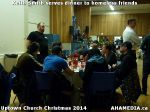 65 Keith Smith serves dinner to homeless friends at Uptown Church Christmas 2014