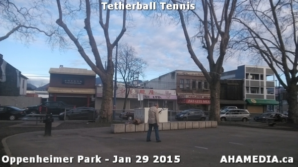 1 AHA MEDIA sees man playing tetherball tennis in Oppenheimer Park in Vancouver DTES